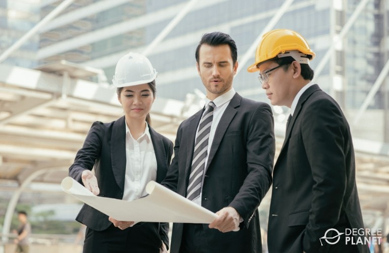 Civil Engineers looking at a plan in a construction site