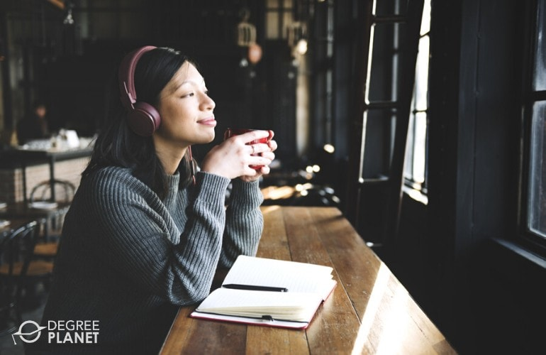 Author thinking while drinking her coffee