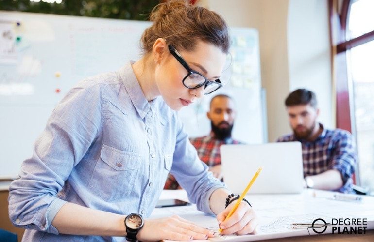 Web Designer drafting on a paper