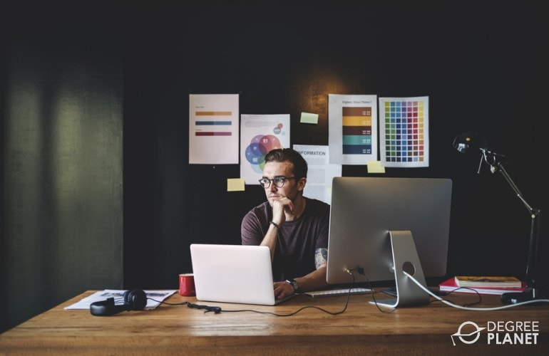 graphic designer working in his office