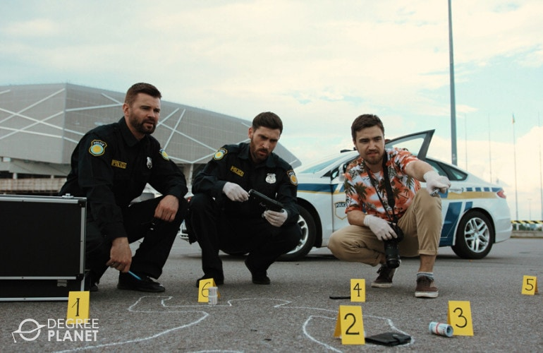 crime scene analysts investigating a crime