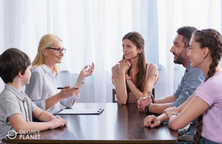 Family counselor talking to a family