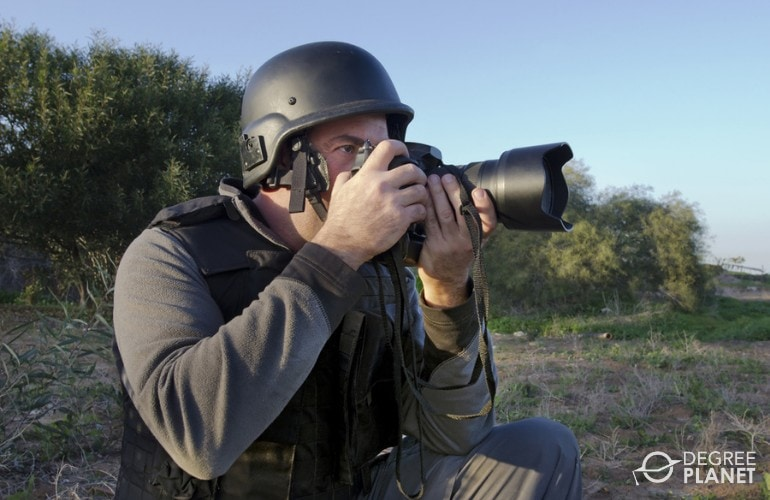 Photojournalist working in the field
