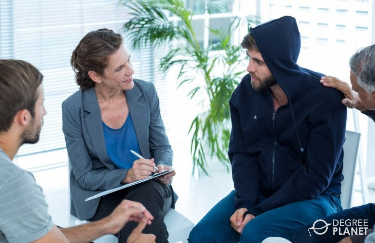 Mental Health Counselor talking to a patient during group counseling