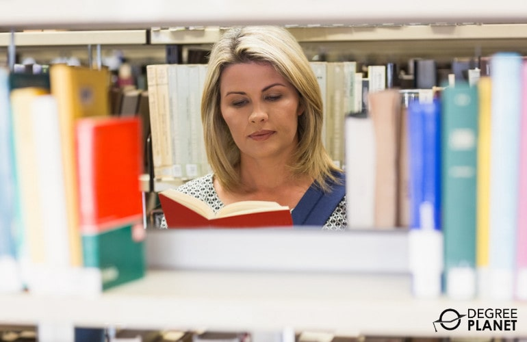 Adult college student in library