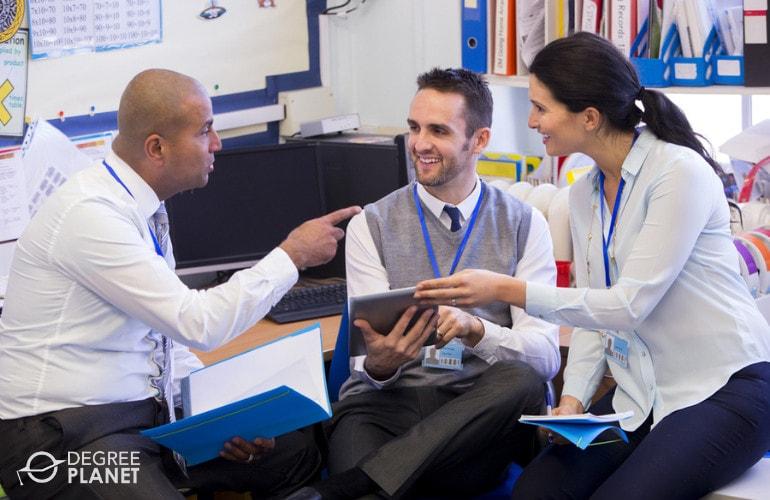 Head teacher talking with fellow teachers