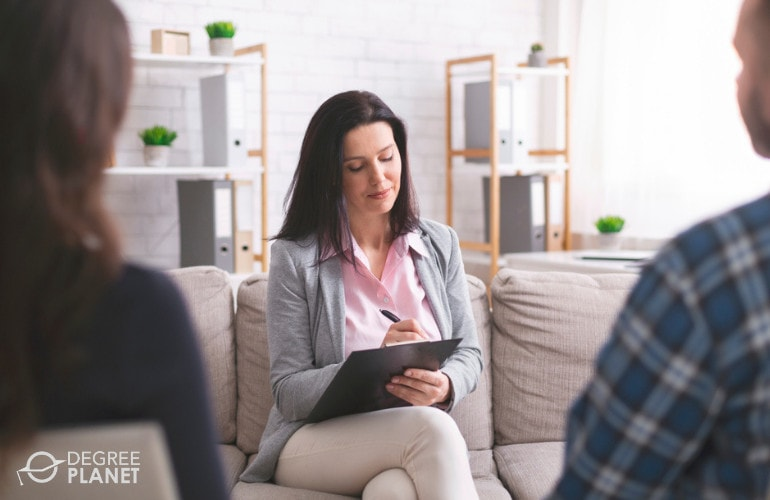 Psychologist with clients during a consultation