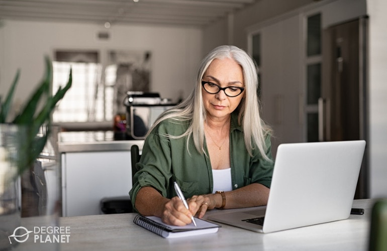 Adult student studying online at home