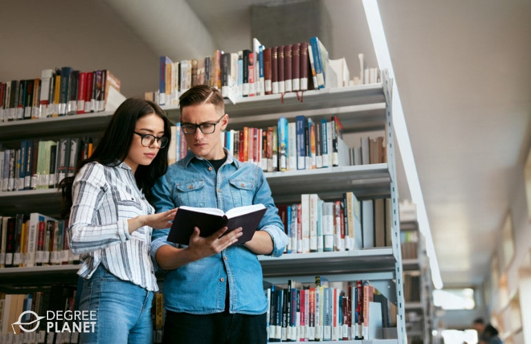 associate degree students studying in library