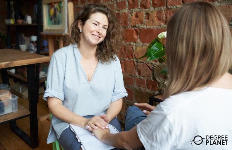 Psychologist comforting her patient