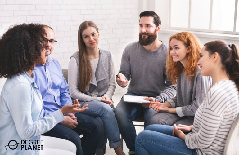 Psychologist with patients during group therapy