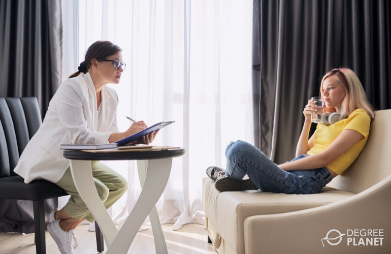 Psychologist with a teenager during consultation