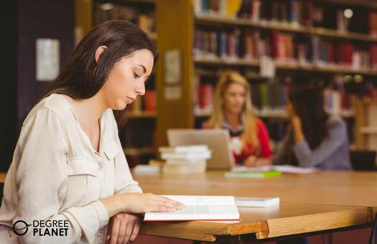 Emergency Management Degree student studying in a library