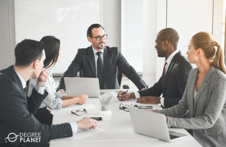 Business Operations Specialists in a meeting