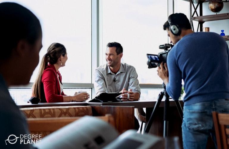 Journalist interviewing a politician