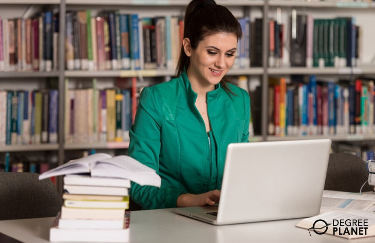 Doctorate Degree student studying in library