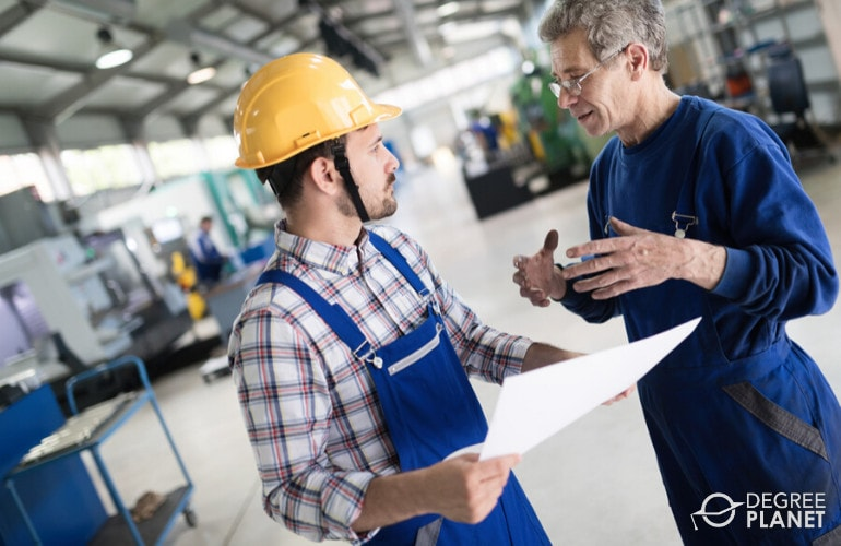 Industrial engineer giving instructions to an employee
