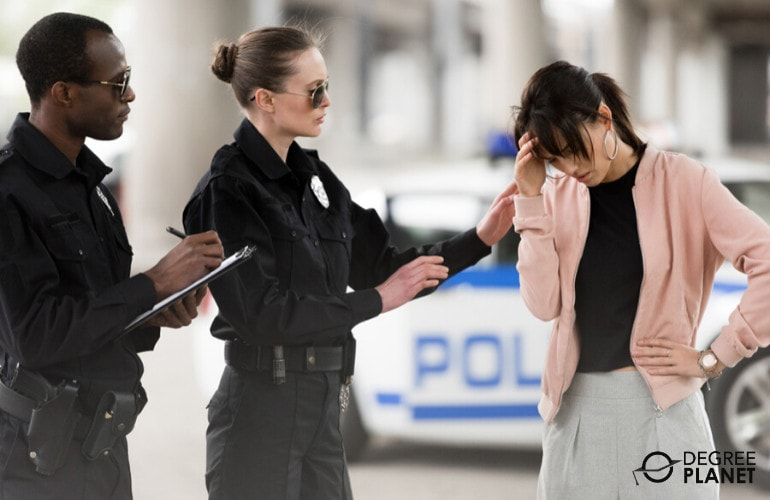 Law Enforcement Officer interviewing a woman