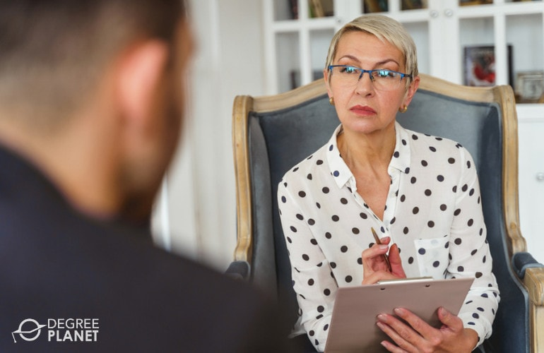 Psychologist with a client in her office