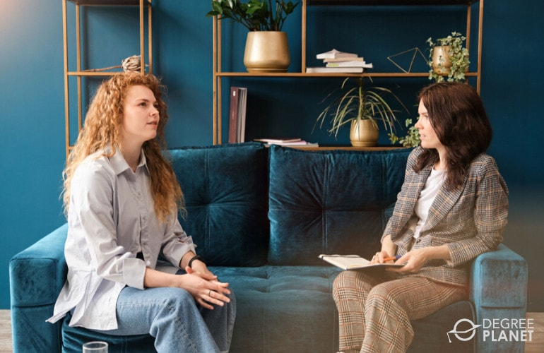 Psychologist talking to a patient