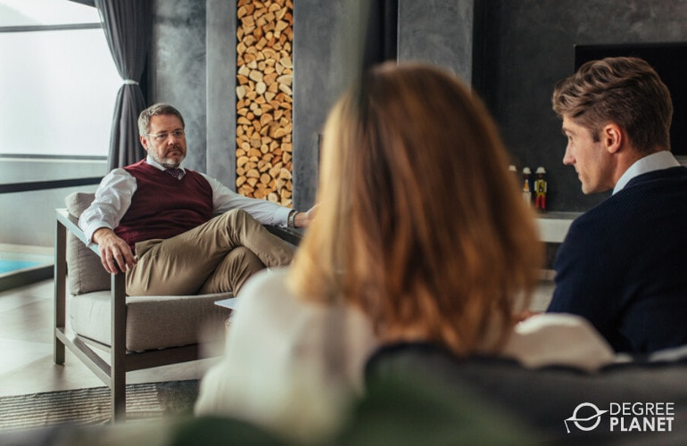 Psychologist with a couple during consultation