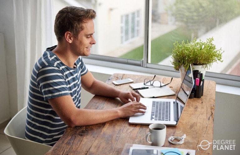 Writer working on his laptop